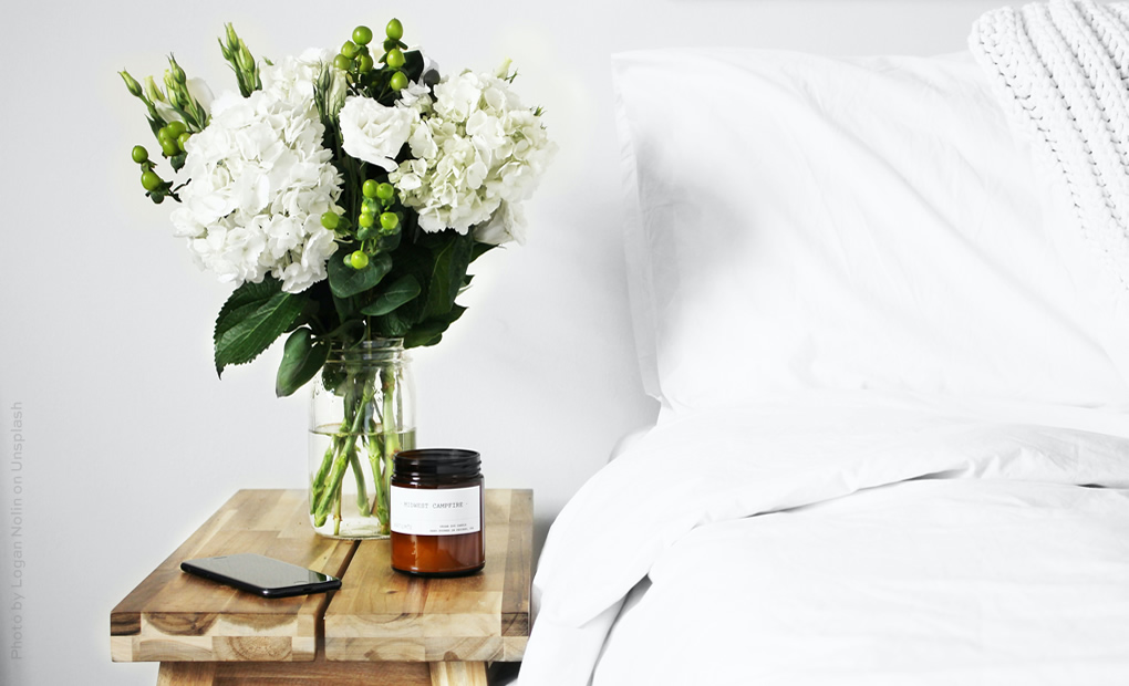 flowers and candle on bedside table