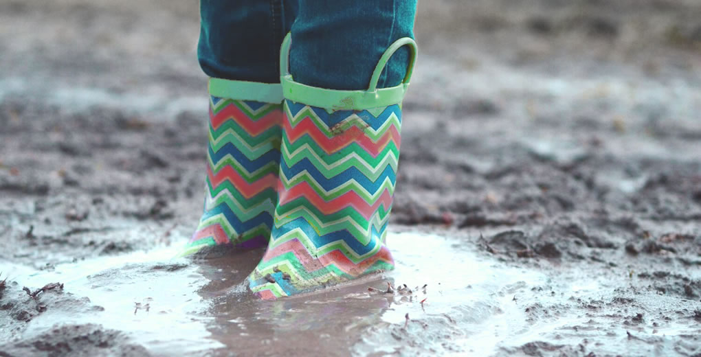colorful rainboots stuck in mud